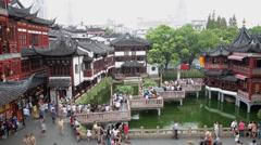 Crowds on nine-turn zig-zag bridge at Yuyuan Bazaar , Shanghai, China Stock Footage