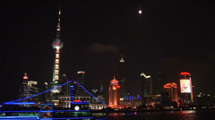 Skyline of Pudong with Oriental Pearl TV Tower and Sight Seeing Boat on the - stock footage