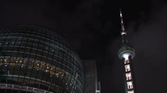 Oriental Pearl TV Tower and the lit Buildings of Pudong at Night Stock Footage