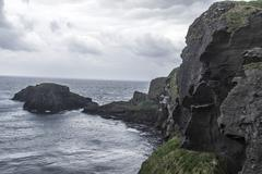 carrick-a-rede rope bridge in northern ireland - stock photo