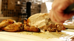 man's hands carving roasted chicken in slow motion. - stock footage