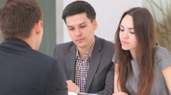 Business 5el S&A&D 037 young attractive couple consults at the business analyst Stock Footage