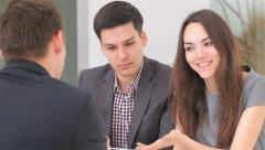 Young attractive couple consults at the business analyst - stock footage
