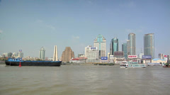 River Boats on the Huangpu River and as Background the Skyline of the Northern Stock Footage