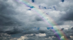 No flicker, Time lapse 4k or HD - dark heavy clouds and rainbow Stock Footage