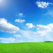 blue skies with clouds and green meadow - stock illustration