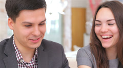 business 5el S&A&D 049 young attractive couple consults at the business analyst - stock footage