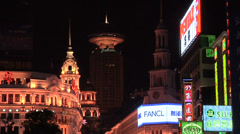 Well lit Buildings and Neon Signs on Nanjing Road East Stock Footage