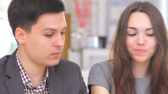 business 5el S&A&D 051 young attractive couple consults at the business analyst - stock footage