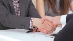 Young attractive couple consults at the business analyst Stock Footage