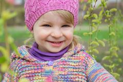 Baby outdoor among blooming willow Stock Photos
