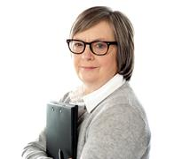 Attractive old orporate lady holding business document - stock photo