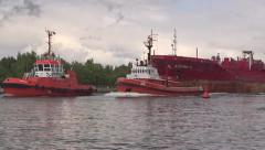 Two tugboats tow the SUSANA S oil/chemical tanker ship to the port in Gdansk Stock Footage