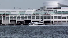 Water Plane taking off from Coal Harbor/ Canada Place VancoUVer Stock Footage