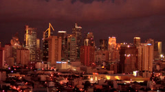 Sunset illuminating the Skyline of Makati Manila Philippines Stock Footage