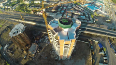 Construction site with crane  and highway shot from UAV quadcopter Stock Footage