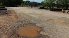Pot Holes on County Road Stock Footage