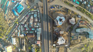Stock Video Footage of Construction site with crane  and highway shot from UAV quadcopter