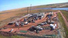 Aerial of large fracking operation Stock Footage