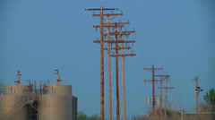 Oil Well Tanks W Power Lines Close Stock Footage