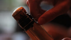 Champagne cork untwist Stock Footage