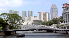 Singapore River with Tourist Boats and the Cavenagh Bridge and the Skyline of Stock Footage