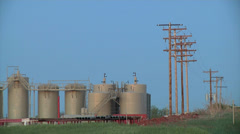 Oil Well Tanks W Power Lines 1 Stock Footage
