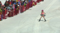 Skier in tutu crashes into water Stock Footage