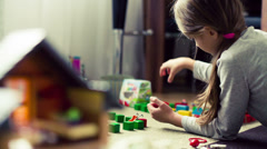 Girl playing with bricks Stock Footage
