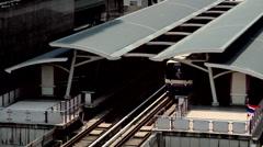 The Skytrain at the Sala Daeng Station Bangkok Stock Footage