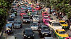 Afternoon Traffic besides the Chatuchak Market on Kamphaeng Phet Bangkok Stock Footage