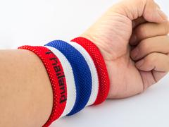 The wristband have colourful on wrist human for cheer Stock Photos