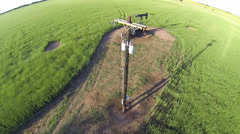 Oil Well Aerial with Power Lines Stock Footage