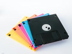 colourful diskette is thin and flexible magnetic storage medium - stock photo