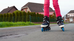 Girl riding on roller blades Stock Footage