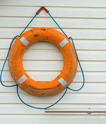 life buoy with rope hanging around the pool - stock photo