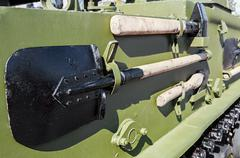 Entrenching tools mounted on armored tank Stock Photos