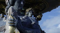 Beautiful Fountain in Paris, strong man sculpture holding fish Stock Footage