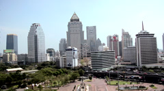 Skyline of Buildings in Silom and Sathon District with Lumphini Park in Stock Footage