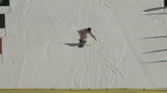 Snowboarder backflips into pond Stock Footage