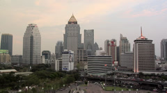 Skyline of Buildings in Silom and Sathon District with Lumphini Park Timelapse Stock Footage