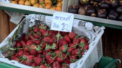 Fruit Vendor at the Market in the Center of Town in New Suthothai Stock Footage