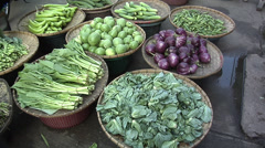 Different Vegetables of a Vegetable Vendor at the Market in the Center of Town Stock Footage