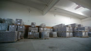 Stock Video Footage of Inside a storage warehouse. Camera moving.