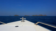 Speed boat floating to the islands in ocean - stock footage