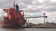 Self discharging bulk carrier is unloading gravel, Gdansk, Poland Stock Footage