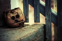 Scary Pumpkin on the Stairs - stock photo