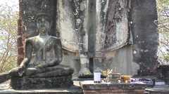 Buddha Statue at the Ruins of Wat Saphan Hin at the Historical Park of old - stock footage