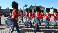 Orchestra marching in front of palace Stock Footage