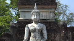 Buddha Statues at the Ruins of Wat Phra Phai Luang at the Historical Park of old - stock footage